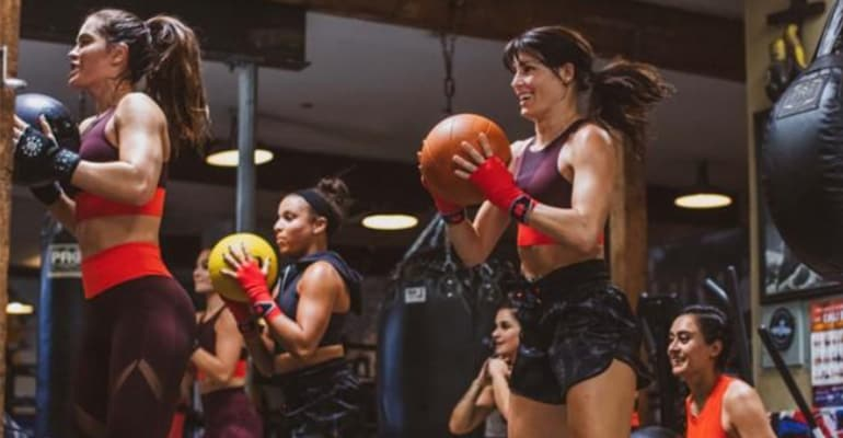 women getting fit with medicine balls