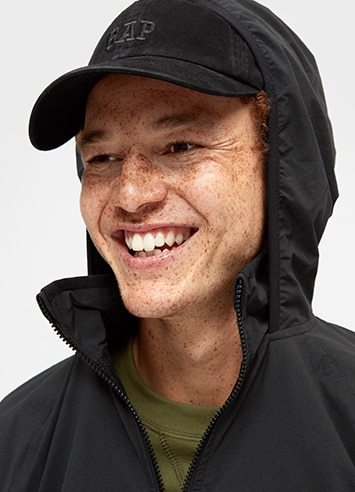 Man in a hoodie and ballcap