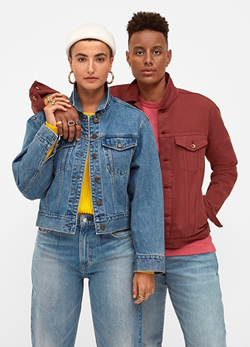 Couple wearing different color denim jackets and jeans