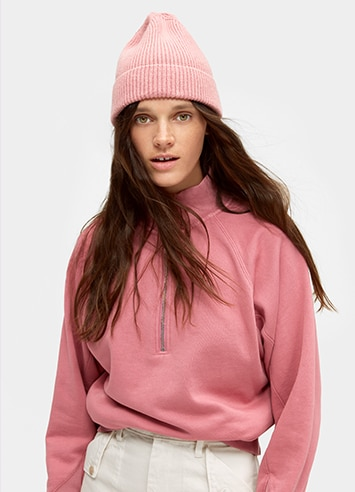 Woman in a knit hat and hoodie