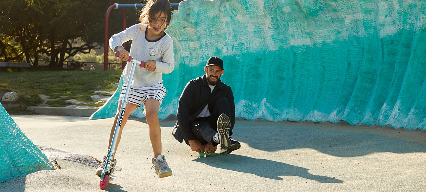 Moriarty playing with his daughter at a skate park