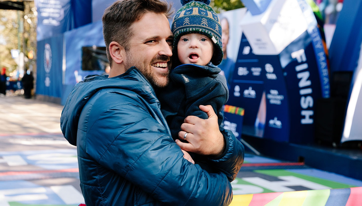 Ketchell holding his son at the end of the race