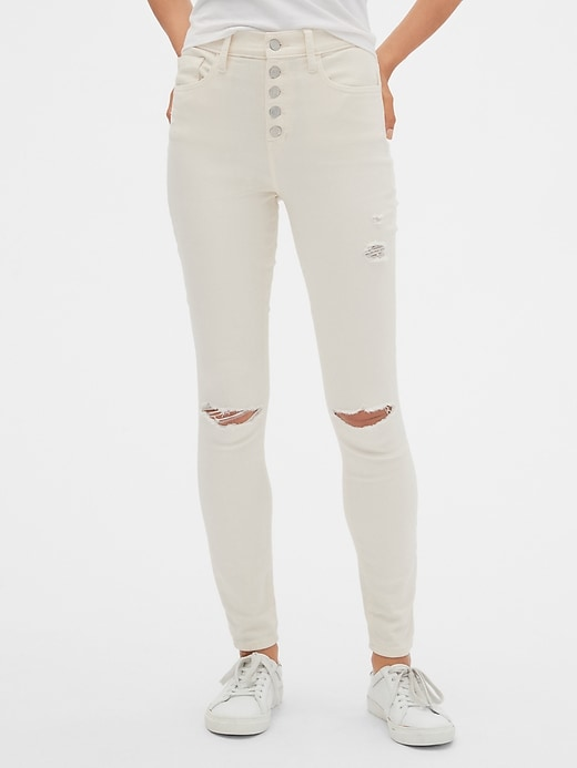 High Rise Distressed Legging Jeans with Button-Fly