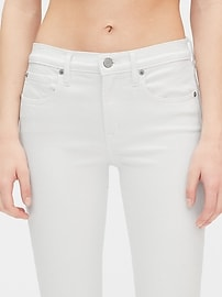 Mid Rise True Skinny Ankle Jeans with Raw Hem